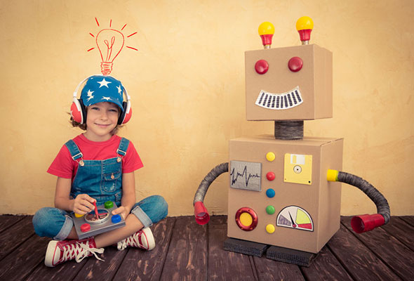 How SEO works - kid with cardboard robot, representing Google bot