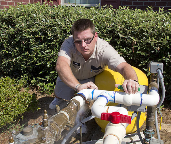 plumber clears backflow device